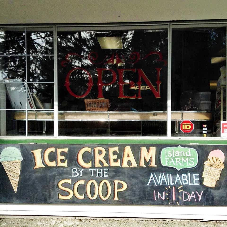 The front of the Glenora Store advertising ice cream for sale.
